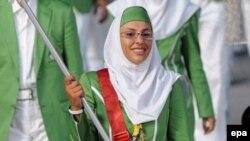 Бейжің олимпиадасында өз елінің туын ұстап шыққан ирандық спортшы Хома Хоссейни. 8 тамыз 2008 жыл. Көрнекі сурет