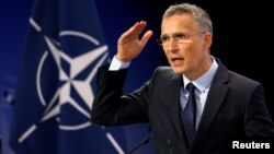Jens Stoltenberg addresses a news conference at NATO headquarters in Brussels on June 28.
