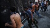 LEBANON - Demonstrators storm a fence during a protest following the blast in Beirut, Lebanon, August 10, 2020