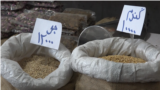 Iran - bags of grain at a food market - food prices have skyrocketed along with inflation - screen grab