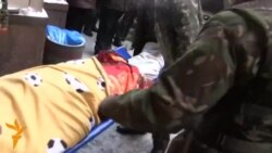 Body Of Killed Ukrainian Protester Leaves Makeshift Hospital
