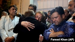 Politicians mourn the death of former lawmaker Ali Raza Abidi in Karachi on December 25.