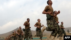 Afghan recruits run in formation at the Afghan National Army Officers' Academy in the Qargha district of Kabul on October 23.