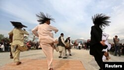 "Afghan men perform the traditional ""attan"" dance in Kabul, April 17 2014."