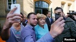 Cancelara Angela Merkel cu refugiați din Siria și Irak, Berlin, septebrie 2015