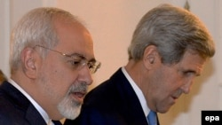 U.S. Secretary of State John Kerry (right) and Iranian Foreign Minister Mohammad Javad Zarif in Vienna before talks on November 24, 2014.