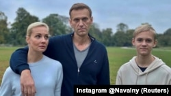 Aleksei Navalny, his wife, Yulia, and son Zahar pose for a picture in Berlin in an image obtained from social media on October 6.