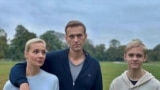 GERMANY -- Russian opposition politician Aleksei Navalny, his wife Yulia and son Zahar pose for a picture in Berlin, in this undated image obtained from social media October 6, 2020