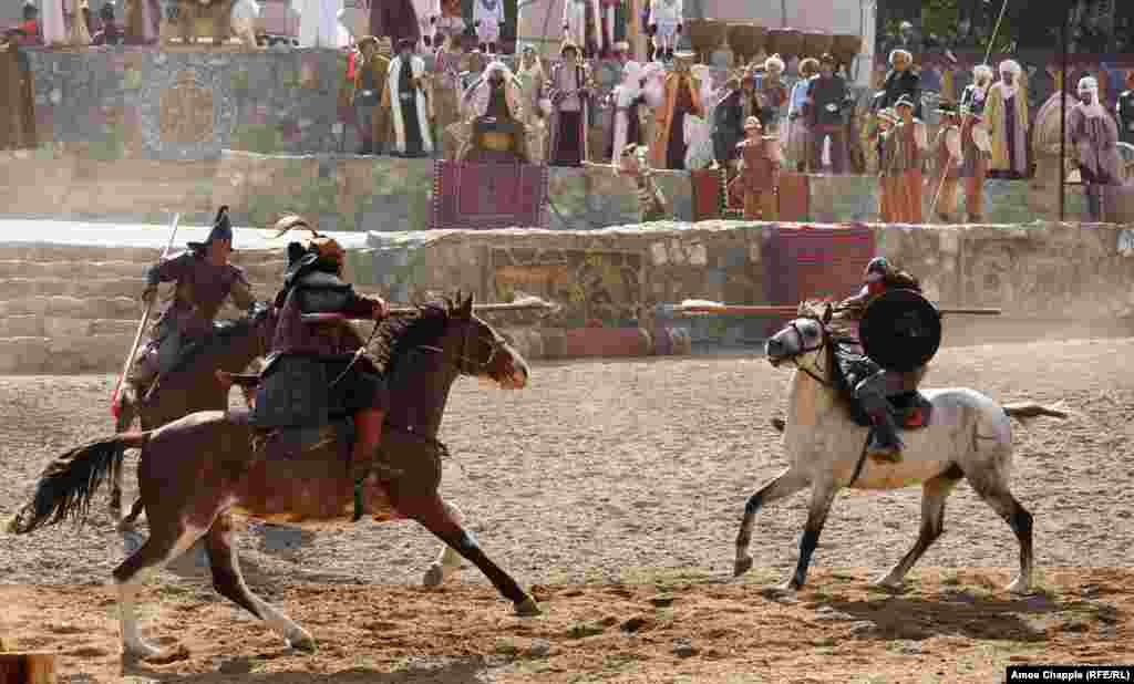 Another traditional Turkic challenge played out as jousters engaged in high-speed passes. Amid the dust-clouded chaos of the ceremony, it was sometimes hard to tell if tumbles were choreographed or painfully accidental.