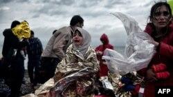 Ці мігранти дісталися грецького острова Лесбос із Туреччини через Егейське море, фото 22 жовтня 2015 року