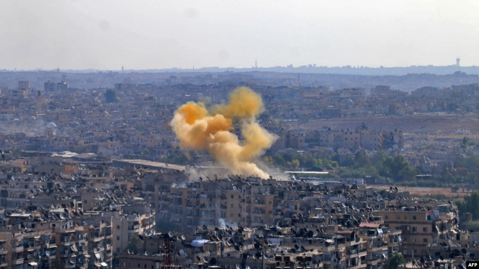 Smoke rises from reported opposition fire from buildings in an eastern government-held neighborhood of the northern city of Aleppo on October 20.