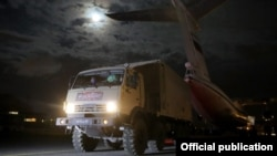 Armenia -- A truck carrying medical equipment is unloaded from a Russian military transport plane at Yerevan airport, April 7, 2020.