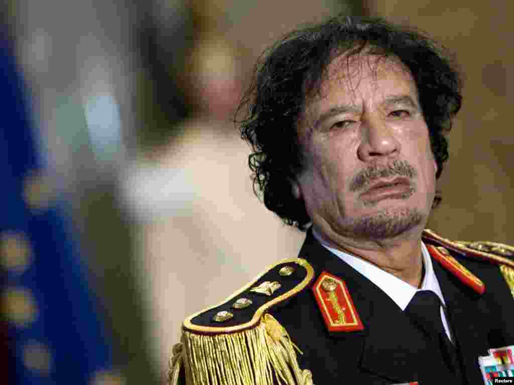 Qaddafi looks on during a news conference in Rome on June 10, 2009.