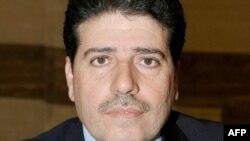 Wael al-Halqi, the former health minister, was appointed Syria's new prime minister.