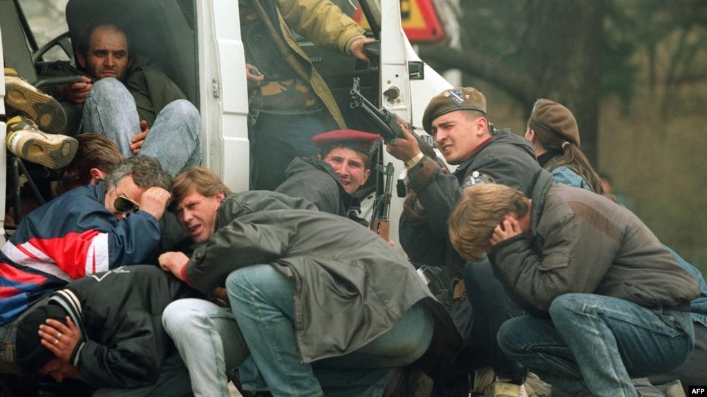A Bosnian Special Forces Soldier Returns Fire Downtown Sarajevo April 6 1992