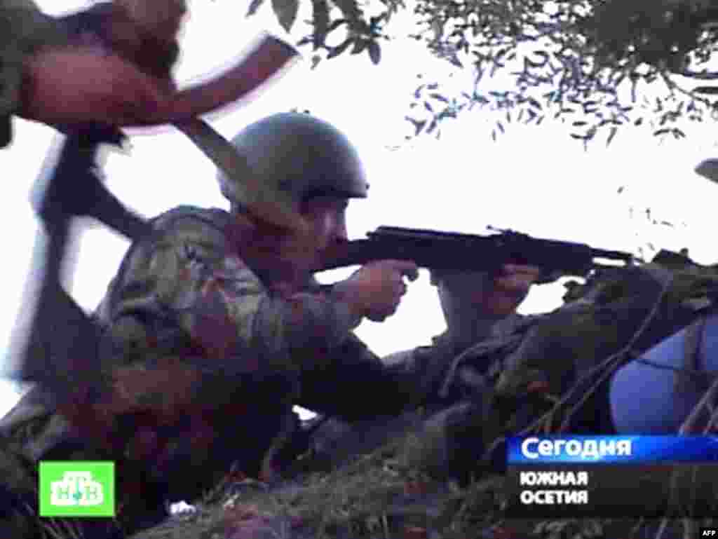 Georgia -- A TV grab shows South Ossetian troops firing at Georgian troops from an unnamed location not far from Tskhinvali, 07Aug2008