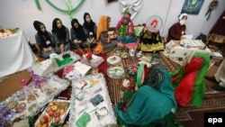 Afghan students display their creations during an exhibition of handicrafts, in Herat, October 2015.