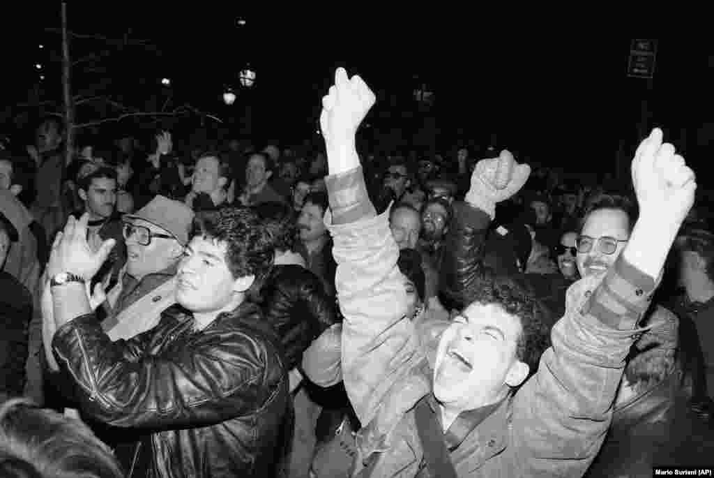 People celebrate in the New York City neighborhood of Greenwich Village after a gay-rights bill is passed on March 20, 1986.
