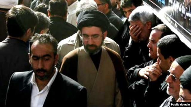 Hard-line cleric Mojtaba Khamenei (center) is the second son of current Iranian Supreme Leader Ali Khamenei.