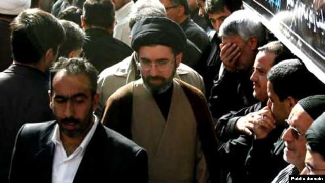 Hard-line cleric Mojtaba Khamenei (center) is the second son of current Iranian Supreme Leader Ali Khamenei.