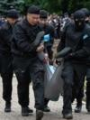 Kazakhstan - Police officers detain an opposition supporter during a protest against presidential election, in Almaty, Kazakhstan, June 9, 2019. REUTERS/Mariya Gordeyeva