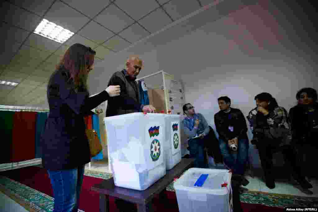 People cast their ballots during the presidential election in Baku.