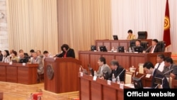 File photo of Kyrgyz parliamentary deputies at work