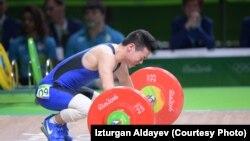 Казахстанский тяжелоатлет Арли Чонтей.