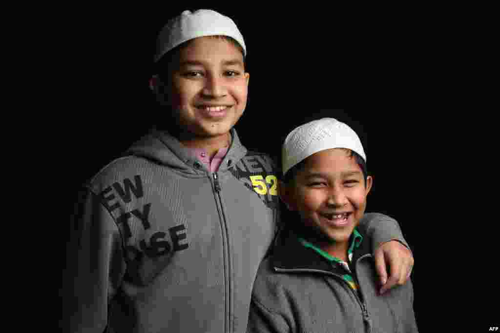 Seventh-grader Mohammed Tamim, 12, and his brother Mohammed Talha, 6, come from Bangladesh. Their father, Mohammed Firoz, is a naturalized American from Bangladesh who works in construction in Brooklyn, New York City.