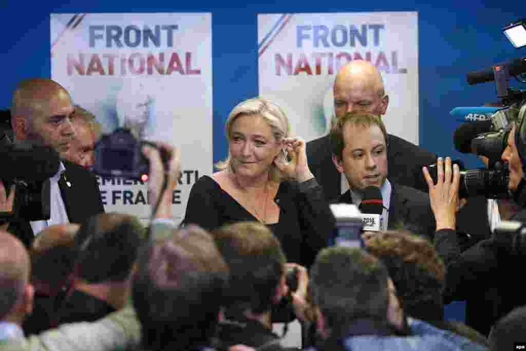 Marine Le Pen (center), the president of France's far-right National Front party, speaks after her party won 26 percent of the country's vote for members of the European Parliament, ahead of the governing Socialists and the center-right Union for a Popular Movement.