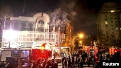 Flames rise from Saudi Arabia's embassy after it was stormed by hardline protesters during a demonstration in Tehran, January 2, 2016. Lack of police intervention led to suspicions of complicity by security forces.