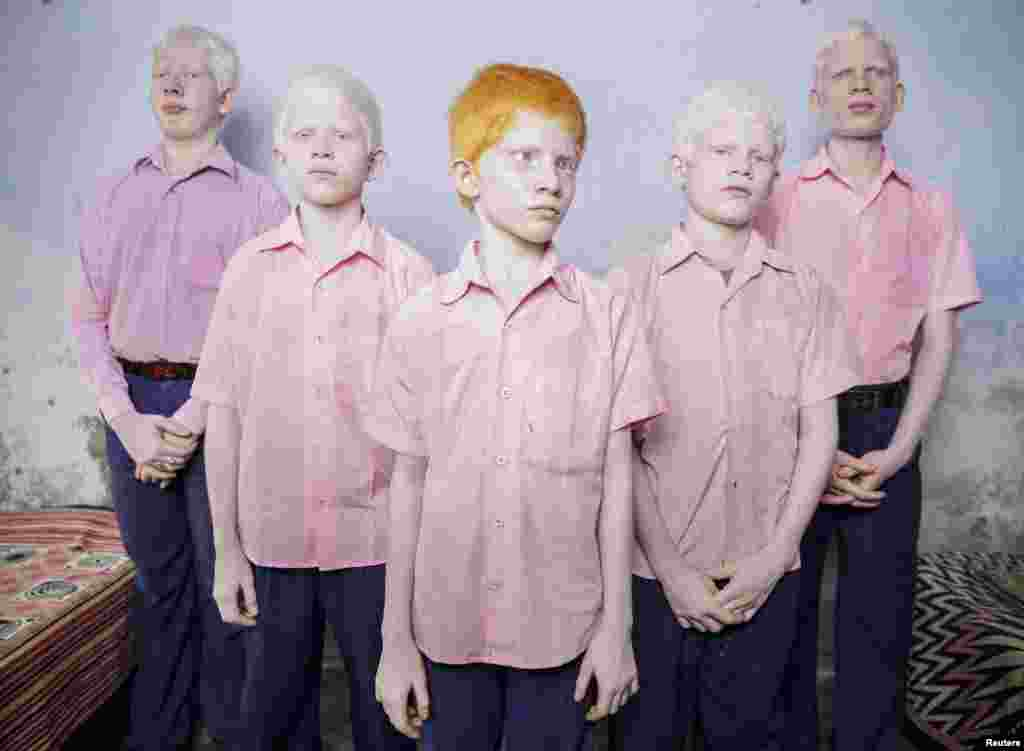 Brent Stirton, a South African photographer working for Reportage by Getty Images, won first prize in the People - Staged Portraits Single category with this picture of a group of blind albino boys in their boarding room at a mission school for the blind in West Bengal, India.