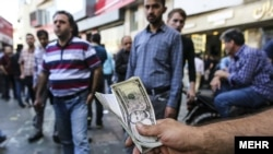 Iran's currency has lost its value five-fold since March, as U.S. sanctions have dealt a heavy blow to economic confidence among people and businesses.