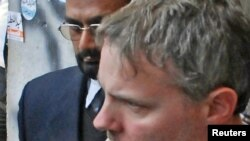 American Raymond Davis is escorted by police and officials out of court in Lahore on January 28.