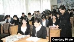 Uzbekistan - Uzbek teacher and her class, undated
