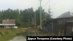 Дорога в городе Нижнеудинске в Иркутской области после наводнения