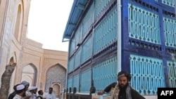 Sufis pray at the Khaja Abdullah Ansari shrine in the western Afghan city of Herat.
