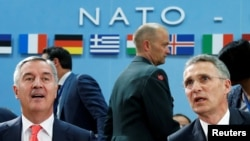 Montenegro's Prime Minister Milo Djukanovic (left) and NATO Secretary-General Jens Stoltenberg attend a NATO foreign ministers meeting at alliance headquarters in Brussels on May 19.