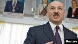 Belarus President Alyaksandr Lukashenka speaks to media at a polling station during local elections in Minsk in April.