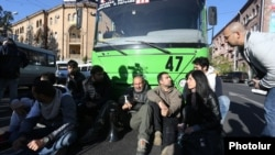 Opposition leader Nikol Pashinian (center) and his supporters block traffic on a street in Yerevan on April 16.