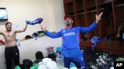 Afghan players celebrate after beating Ireland on March 23.