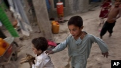 Internally displaced children play at a refugee camp in Kabul in early August.