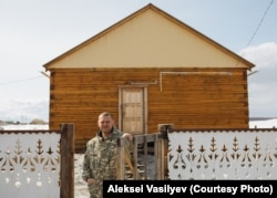 Davydov outside the home he shares with his wife and three children in Amga. His 2020 film Scarecrow won the main prize at Russia's Kinotavr film festival but cost only $20,000 to make.