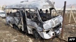 "A burnt bus at the scene of a blast blamed by the Syrian authorities on a ""terrorist group"" near military barracks in Sahnaya on the outskirts of Damascus on January 29."