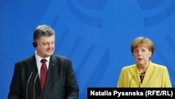 Петр Порошенко и Ангела Меркель на пресс-конференции в Берлине, 16 марта 2015