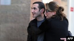 Former Georgian Defense Minister David Kezerashvili (left) embraces his wife, Sophia, as he leaves a prison in Marseille on February 3.