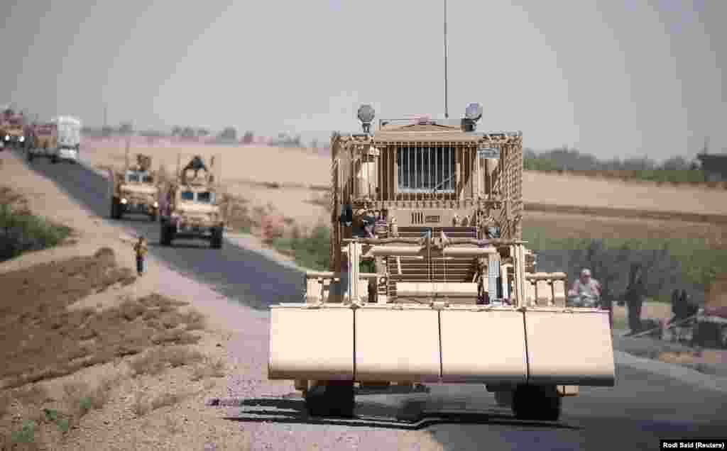 A U.S military demining vehicle leads a convoy near Raqqa in July 2017.