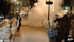 Greek demonstrators clash with riot police in Athens overnight on April 4.