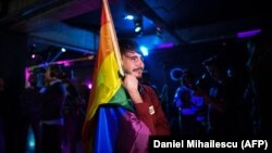 A member of the LGBT community waits for the results of the referendum in Bucharest on October 7.