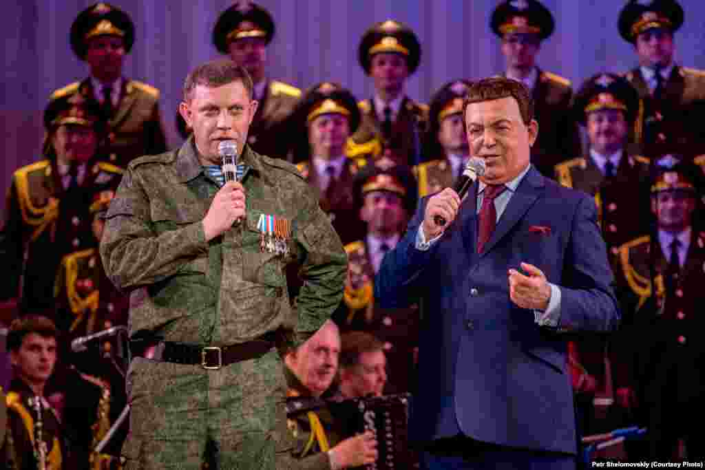 Iosif Kobzon, a singer known for his loyalty to the Kremlin, and Aleksandr Zakharchenko, prime minister of the self-proclaimed Donetsk People's Republic, sing a Soviet-era song together during a concert in Donetsk.